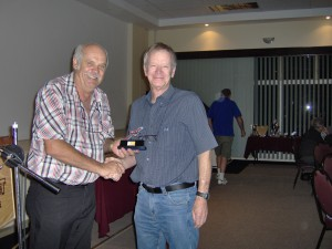 Fred Kunniger Honorary Life member and former Chairman handing over an award to the late Rainer Holzberg.