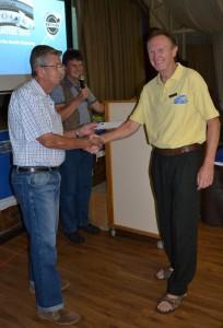 Howard Bates receiving his Honorary Life membership from Leon Spoor.